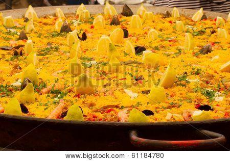 Typical Spanish paella in big pan, street market