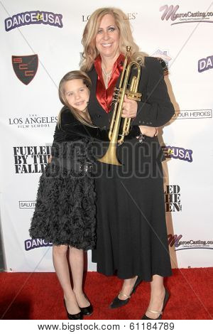 LOS ANGELES, CA - MARCH 6: Deb Wagner and her daughter arrive the Hollywood Comes Out to Salute to Our Heroes fundraiser on March 6, 2014 at the Specialty Car Craft Motorgroup on Los Angeles, CA.