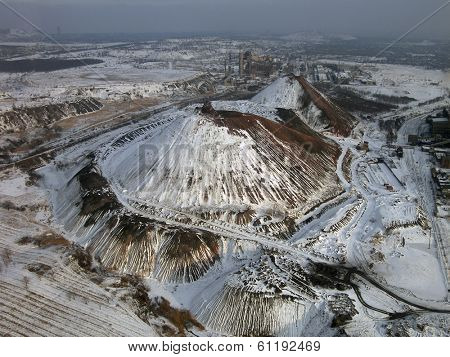 Snow-covered slagheap (aerial view). poster