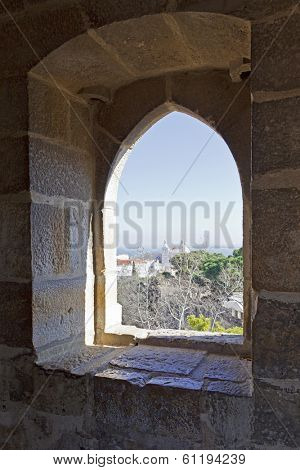 Lisbon, Portugal - February 01, 2013: Gothic window of a tower of the Sao Jorge (St. George) Castle in Lisbon, Portugal.