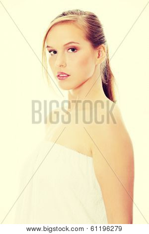 Young beautiful blond teen woman in bathrobe