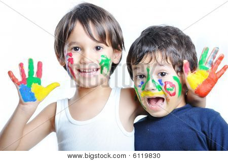 A Little Cute Child With Several Colors On White