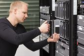 IT technician / engineer install / removes / replace a blade server in a data center. poster