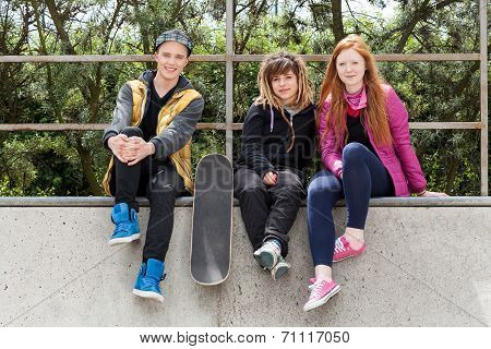 Teenagers Sitting On A Halfpipe