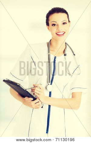 Female doctor using tablet computer , isolated on white.