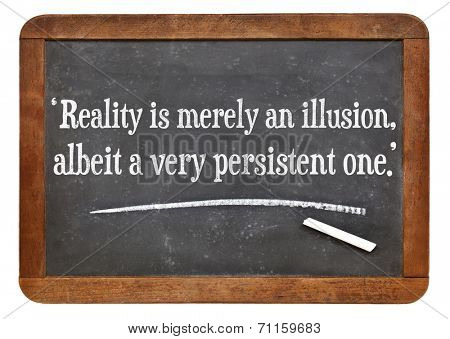 reality is merely an illusion, albeit a very persistent one - a quote from Albert Einstein on a vintage slate blackboard