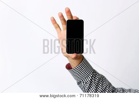 Closeup portrait of a male hand holding smartphone