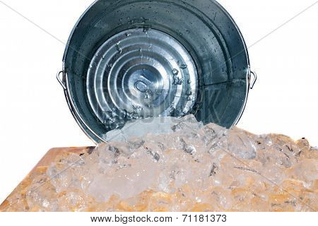 Frozen Water AKA Ice in Cube Form spills out of a steel Ice Bucket. Isolated on white with room for your text. Ice is an important part of any modern society and has many uses around the world.