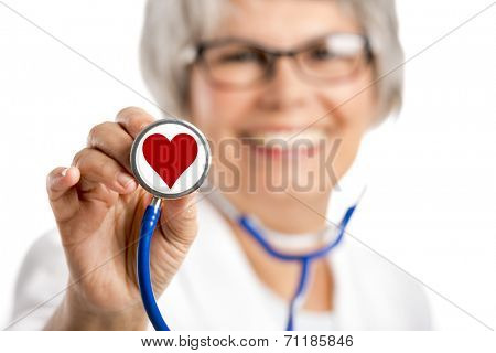 Happy old female doctor holding a stethoscope witha hearth on it, isolated on white