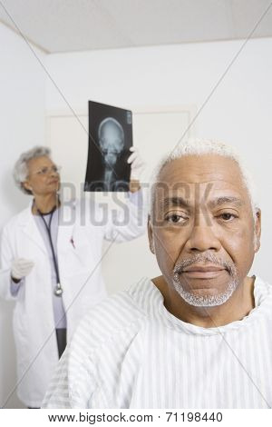 Portrait of senior man waiting for healthcare results