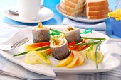 herring rolls with gherkins and apple on white plate poster