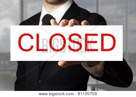 Businessman Holding Sign Closed