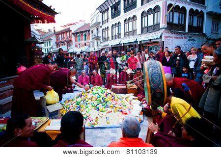 Monks distributing food
