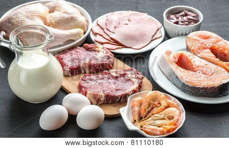 Protein Diet: Raw Products On The Wooden Background poster