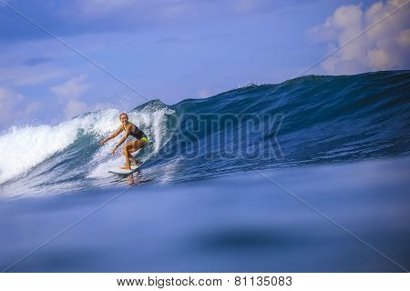Surfer Girl On Amazing Blue Wave