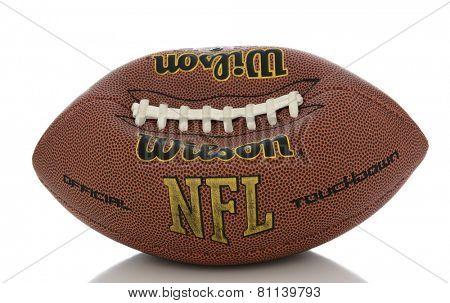 IRVINE, CA - JANUARY 23, 2015: A Wilson NFL Official Football on white with reflection. An under inflated football like the one used in the current controversy called  deflate-gate.