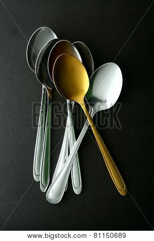 Golden Spoon among ordinary spoons