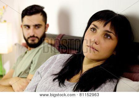 Boyfriend Looking Sad Girlfriend In Bed After Fight