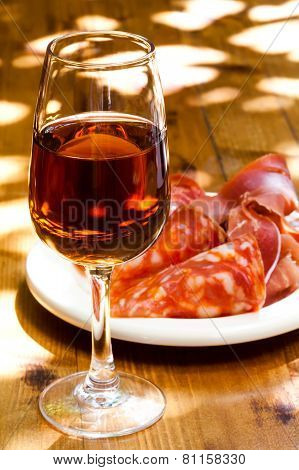 Glass Of Sherry With A Snack (ham, Jamon, Parma).