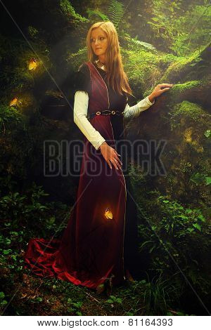A beautiful woman fairy with long blonde hair in a historical gown is turning her head just to have a glimpse of shining golden butterflies flying around her in the deep woods poster