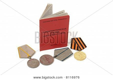 Soviet communist party membership card surrounded by old medals isolated