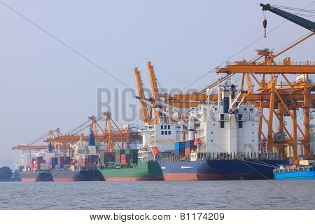Commercial Container Ship On Port Use For Water Transport And Ship Yard Crane Loading Goods