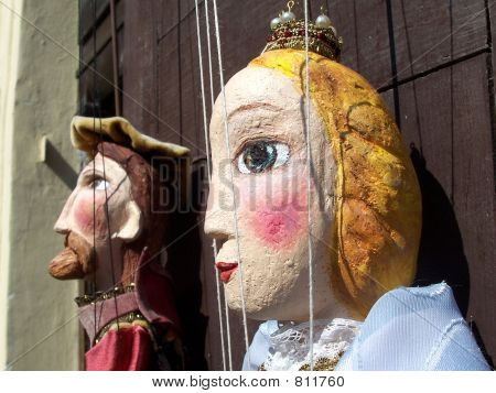 Persons of Puppets on a door of shop of souvenirs in old city in Prague