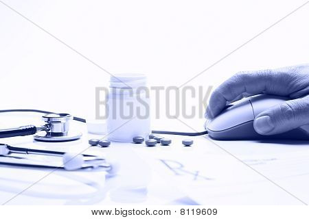Prescription Medicine And Hand On Computer Mouse