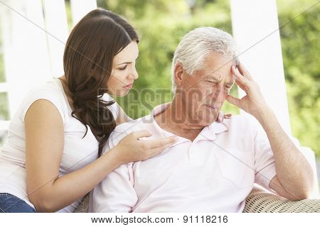 Adult Daughter Talking To Depressed Senior Father