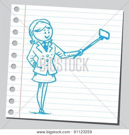 Businesswoman taking selfie with selfie stick
