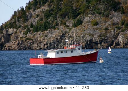 red fishing boat waiting to take you to the day's catch! poster