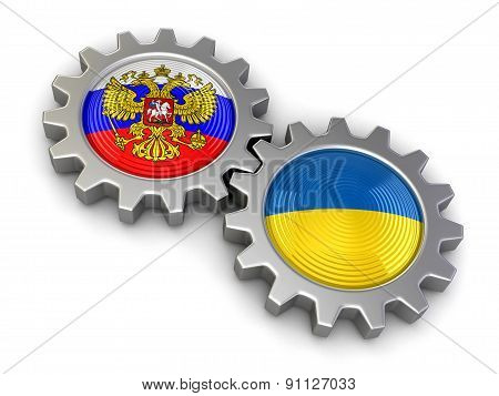 Ukrainian and Russian flags on a gears (clipping path included)