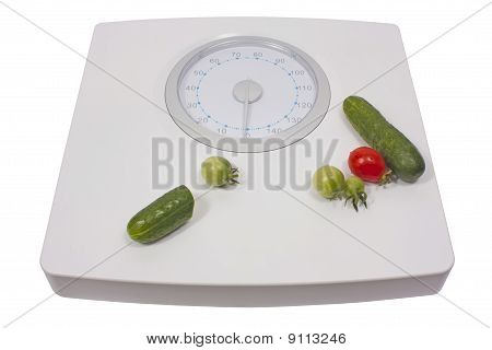 Scale with fresh vegetables for diet