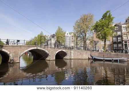 Bridge Over Canal In Centre Of Amsterdam