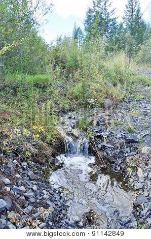 Stream, Babbling Over The Rocks In Yakutia.