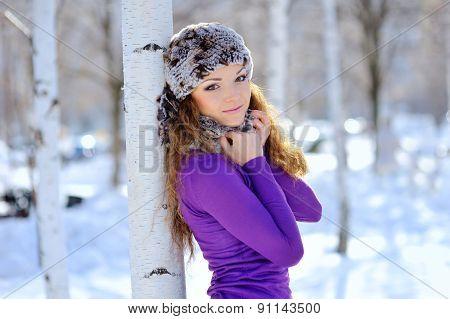 Beautiful Brunette Standing Near Birch In Winter