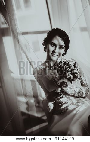 Silhouette Of The Bride Weared In Dress And Veil With A Bouquet