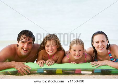 Family Having Fun In Sea On Airbed