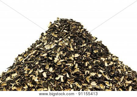 Pile of waste from seeds on white