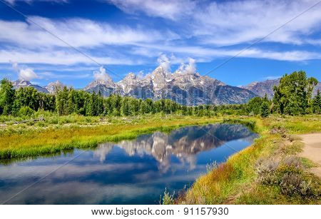 Landscape View Of Grand Teton Mountains  With Water Reflection, Usa