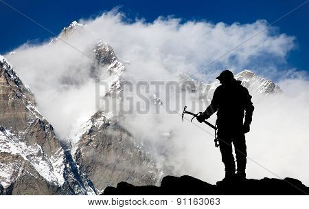 Mount Lhotse And Silhouette Of Man Wirh Ice Axe