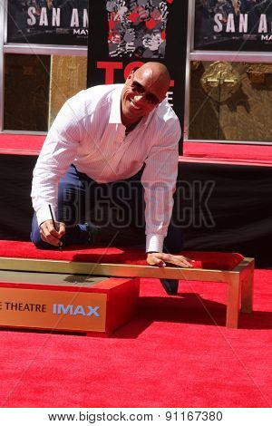LOS ANGELES - MAY 19:  Dwayne Johnson, The Rock at the Dwayne Johnson Hand and Foot Print Ceremony at the TCL Chinese Theater on May 19, 2015 in Los Angeles, CA