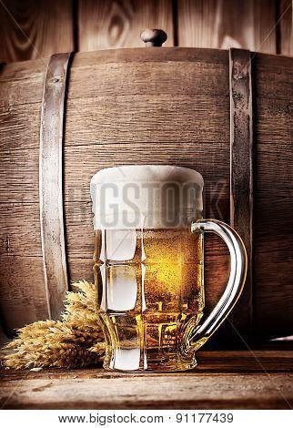 Faceted mug of light beer