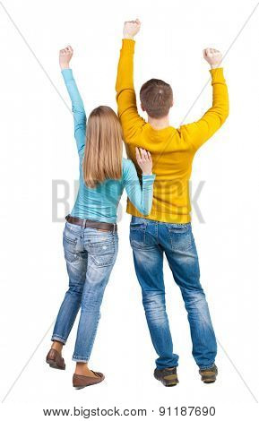 Back view of dancing young couple. Dance party. backside view of person.  Rear view people collection. Isolated over white background. A pair of fans raised their hands up with joy.
