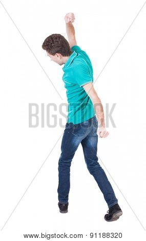 back view of skinny guy funny fights waving his arms and legs. Isolated over white background. Rear view people collection.  backside view of person. The guy in the blue sweater holds uppercut