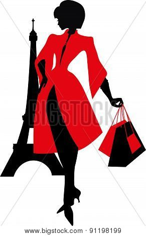 Elegant silhouette. Beautiful woman with the Eiffel Tower.