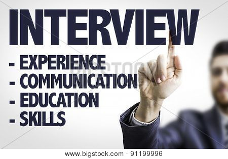 Business man pointing the text: Interview