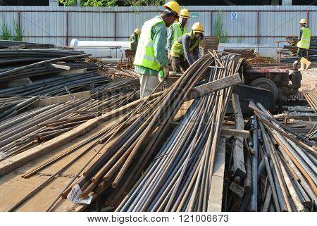 SEPANG, MALAYSIA - APRIL 08, 2015: Bar bending yard at the construction site. Construction workers bend the reinforcement bar follows the design.