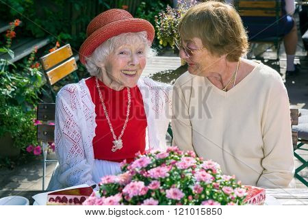Cute Senior Ladies Smiling And Talking.