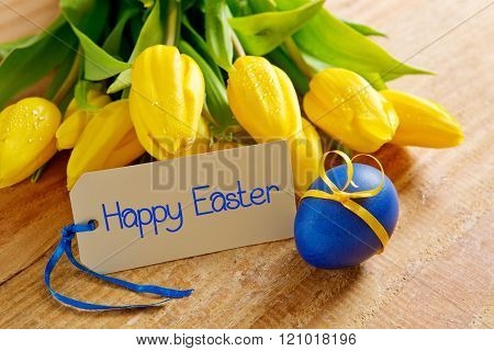 Yellow tulip bouquet  and easter egg isolated .